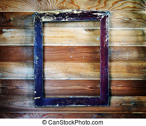 Old vintage wooden frame hanging on the wall