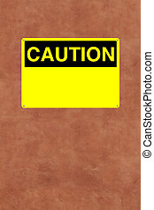 Caution - A blank caution sign mounted on a wall