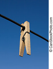 Clothes-peg - Wooden clothes-peg hang on rope on sky...