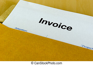 invoice - Billing invoice in the envelope on the table.