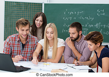 Group activity in the classroom with a diverse multiethnic...
