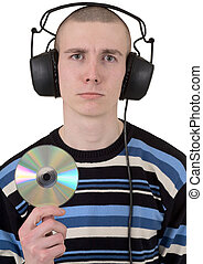 Man in ear-phones and disk on white