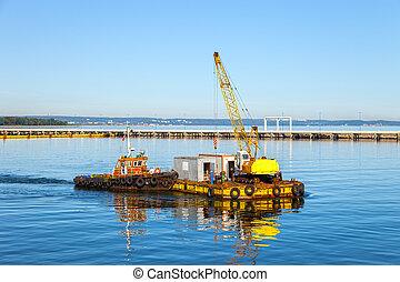 Floating pontoon and crane - Specialized equipment for water...
