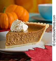 Pumpkin Pie - A delicious slice of fresh pumpkin pie with...
