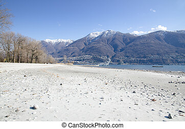 Beach and snow-capped mountains - Beach with white sand an...