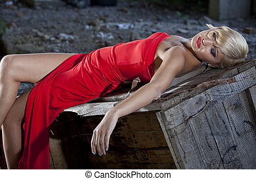 Crime scene - Beautiful woman in retro look playing a dead...