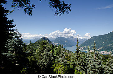 Panorama view over lake with mountains - Panorama view over...