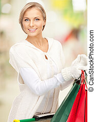 shopper - picture of lovely woman with shopping bags