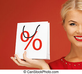 woman holding bag with percent sign - holidays, sale,...