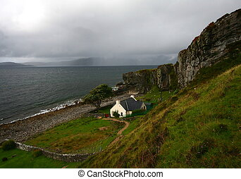 Isolated house and scottish landscape at port elgol, isle of...