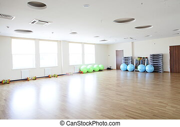 bright gymnasium with big mirror - empty and full of light...