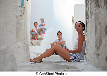 Young mother background her cute daughters and husband in a...