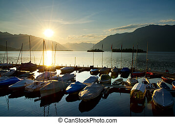 Port in sunrise - Harbor in sunrise over an alpine lake with...