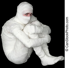 Egyptian mummy emo sitting on the black background