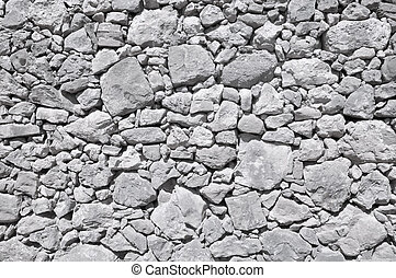 grey old wall made of big and little stones - grey old wall...