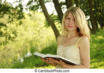 young girl reads the Bible - a young girl reads the Bible