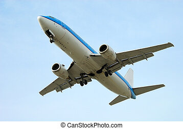 airplane on takeoff with blue sky background