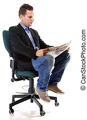 Businessman reading a newspaper isolated - Full length...