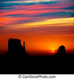 Sunrise at Monument Valley West and East Mittens Butte Utah...