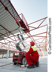 construction worker with lift equipment
