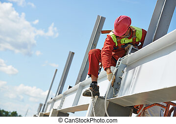 builder millwright worker at construction site - worker in...