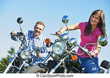 Young couple outdoors on bikes