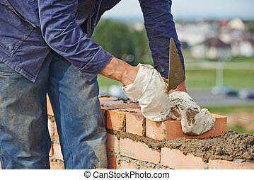 construction bricklayer work - Close-up of construction...