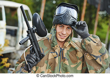 Man paintball player - Happy paintball sport player man in...