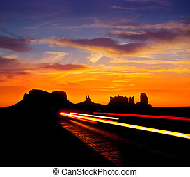 Sunrise on US 163 Scenic road to Monument Valley Park with...
