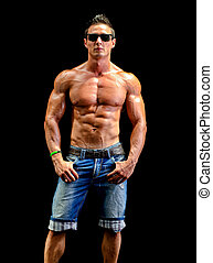 Handsome young muscle man naked wearing only jeans and...