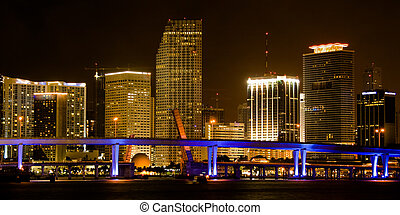 Miami Cityscape - Skyscrapers lit up at night, Miami,...