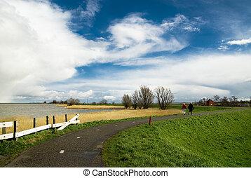 dutch landscape with a couple walking