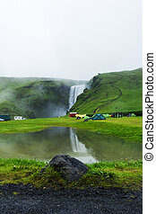tent camp near Skogarfoss waterfall in Iceland, raining...