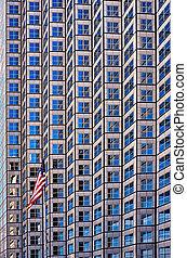 Skyscraper in Miami - Low angle view of American flag...