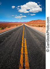 Never ending road to Death Valley California sunny desert