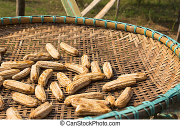 Sundried Banana on a rice-winnowing basket Thai style
