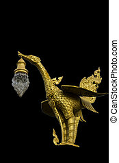 Gold swan lamp in Thailand.