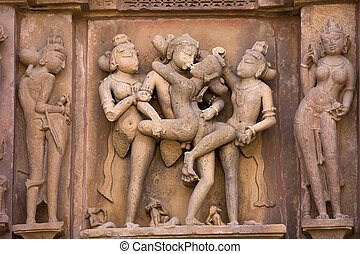 Erotic temple in Khajuraho, India - Stone carved - fragment...