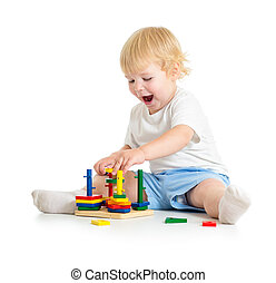 Kid playing logical education toys with great interest