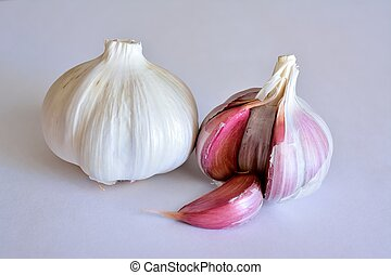 Feeding - Two heads of garlic with white background