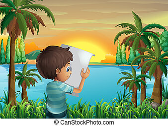 A boy with a paper at the riverbank