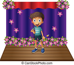 A stage with a young boy holding a bow and arrow -...