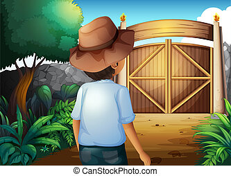 A man with a hat inside the gated yard