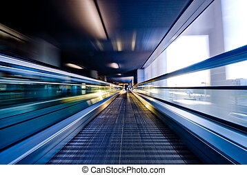 moving escalator - abstract image a moving escalator (BLURRY...