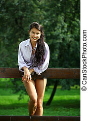 Sexy young Brunette in a summer park