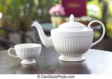 Tea pot with tea and cup delicious