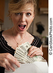 Money in the mail - Blond woman in casual attire with a...