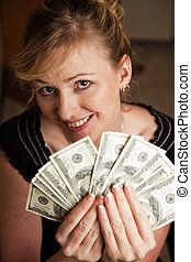 Lots of money - Blond woman in casual attire smiling sitting...