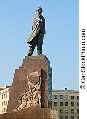 Statue of Lenin in Kharkov, Ukraine, over blue sky.