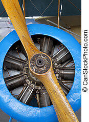 Old aircraft engine with wood propeller, vintage plane close...